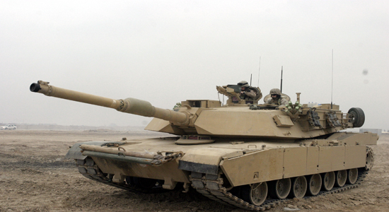 U.S. Marines perform premission checks on an M1A1 Abrams Tank in Camp Fallujah, Iraq, Jan. 21, 2007. (U.S. Marine Corps photo by Lance Cpl. Joseph A. Lambach) (Released)