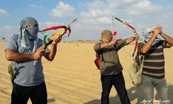 «تیراندازی با کمان» شیوه جدید مبارزه فلسطینیها در راهپیماییهای بازگشت+تصاویر