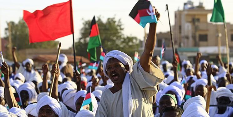 علل اعتراضات در سودان و ارتباط آن با قطع روابط با ایران و سفر البشیر به سوریه